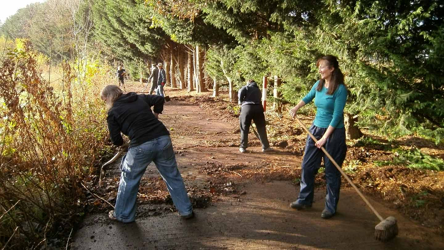 Volunteer rangers working on a path