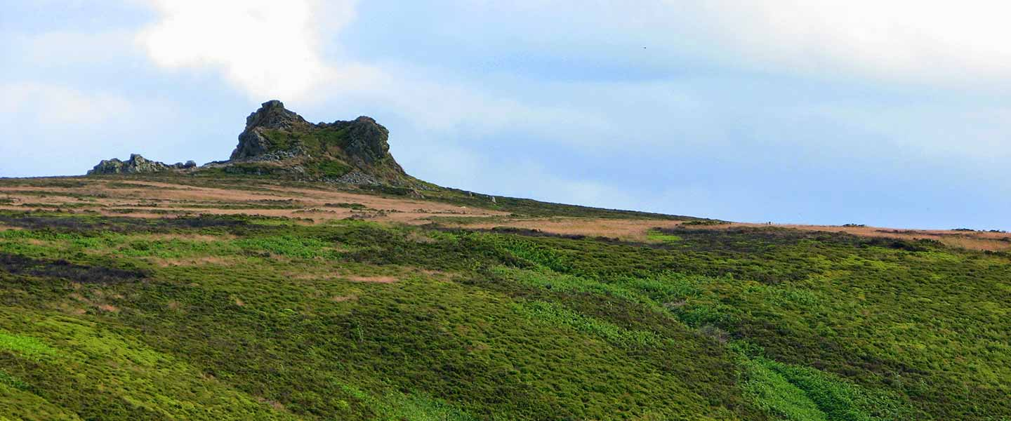 Landscape view of fields and stone mound on Stiperstones Hill